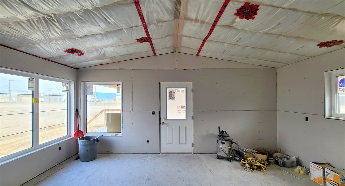White drywall inside of home withe door