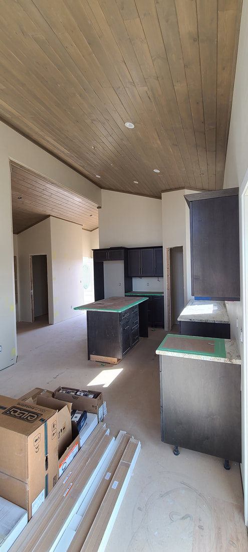 Side view of kitchen being installed RTM