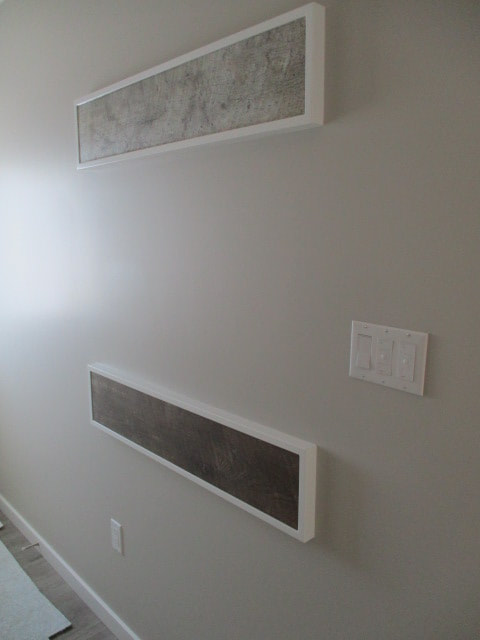 White wall with two building samples on it