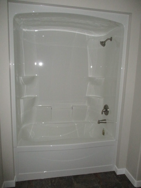 White shower and tub enclosure