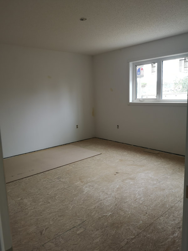 Room with white walls and one window