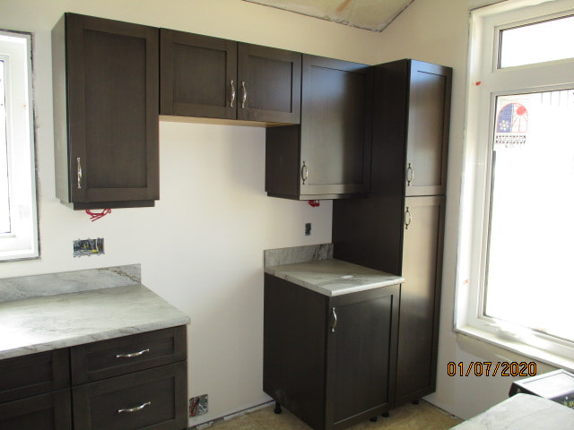 Kitchen with brown cabinets RTM
