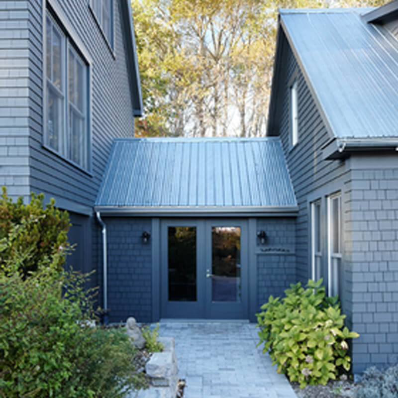 Blue brick house and metal roof