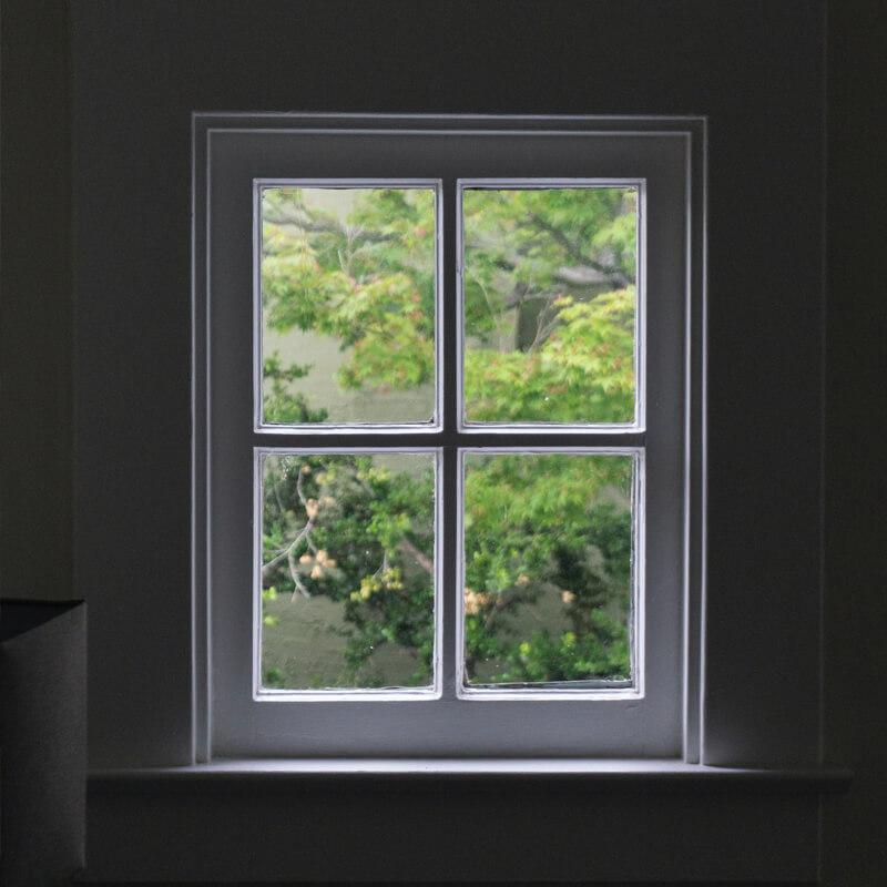 White window with 4 panes dark room